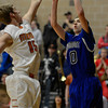 Mead's Griffin Nelson tries to block Longmont's Justinian Jessup Saturday night Jan. 26, 2013 at Mead High School. (Lewis Geyer/Times-Call)