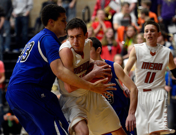 Mead's Ryan Lozinski is covered by Longmont's Marcus Johnson Saturday night Jan. 26, 2013 at Mead High School. (Lewis Geyer/Times-Call)
