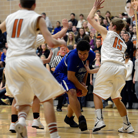 Longmont's Marcus Johnson is covered by Mead defenders Saturday night Jan. 26, 2013 at Mead High School. (Lewis Geyer/Times-Call)