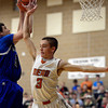 Mead's Taylor Desch tries to block Longmont's Austin Kemp Saturday night Jan. 26, 2013 at Mead High School. (Lewis Geyer/Times-Call)