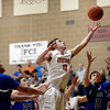 Mead's Ryan Lozinski goes after a rebound against Longmont Saturday night Jan. 26, 2013 at Mead High School. (Lewis Geyer/Times-Call)