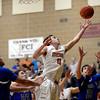 Mead's Ryan Lozinski goes after a rebound against Longmont Saturday night Jan. 26, 2013 at Mead High School. (Lewis Geyer/Times-Call)