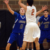 Mead's Aaron Cheung is covered by Longmont's  R.J. Johnson Saturday night Jan. 26, 2013 at Mead High School. (Lewis Geyer/Times-Call)