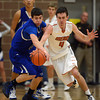 Longmont's Austin Kemp and Mead's Ryan Lozinski battle for the ball Saturday night Jan. 26, 2013 at Mead High School. (Lewis Geyer/Times-Call)
