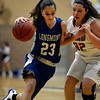 Longmont's Kathryn Schell drives past Mead's Samantha Kalivas Saturday night Jan. 26, 2013 at Mead High School. (Lewis Geyer/Times-Call)