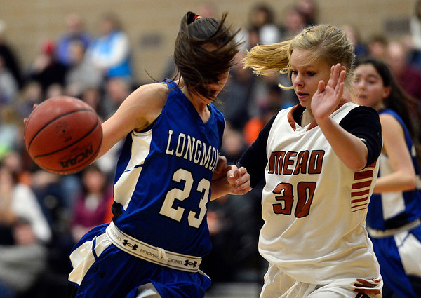 Longmont's Kathryn Schell moves the ball against Mead's Madi Sheffield Saturday night Jan. 26, 2013 at Mead High School. (Lewis Geyer/Times-Call)