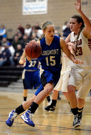 Mead's Kari Lozinski covers Longmont's Sydney Wetterstrom Saturday night Jan. 26, 2013 at Mead High School. (Lewis Geyer/Times-Call)