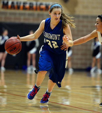Longmont's Megan Tulenko moves the ball down court against Saturday night Jan. 26, 2013 at Mead High School. (Lewis Geyer/Times-Call)