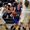 Longmont's Anna Schell drives through Mead traffic Saturday night Jan. 26, 2013 at Mead High School. (Lewis Geyer/Times-Call)