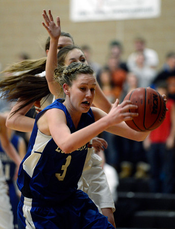 Longmont's Gabriella Fallon is fouled by Mead's Rylee Ward Saturday night Jan. 26, 2013 at Mead High School. (Lewis Geyer/Times-Call)