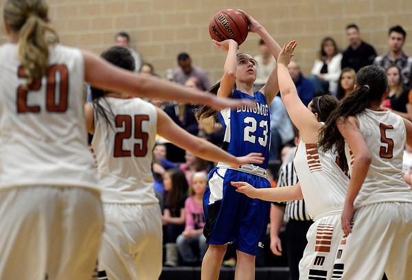 Longmont's Kathryn Schell takes a shot in the first quarter against Mead Saturday night Jan. 26, 2013 at Mead High School. (Lewis Geyer/Times-Call)