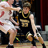 "Monarch's Jay MacIntyre (33) drives around Fairview's Brent Wrapp (3) during the game at Fairview High School on Thursday, Feb. 21, 2013. Fairview beat Monarch 60-51 to clinch the Front Range League title. For more photos visit  <a href=""http://www.BoCoPreps.com"">http://www.BoCoPreps.com</a>.<br /> (Greg Lindstrom/Times-Call)"