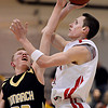 "Fairview's Austin Sparks (41) has a shot blocked by Monarch's Shawn Kirkman (23) during the game at Fairview High School on Thursday, Feb. 21, 2013. Fairview beat Monarch 60-51 to clinch the Front Range League title. For more photos visit  <a href=""http://www.BoCoPreps.com"">http://www.BoCoPreps.com</a>.<br /> (Greg Lindstrom/Times-Call)"