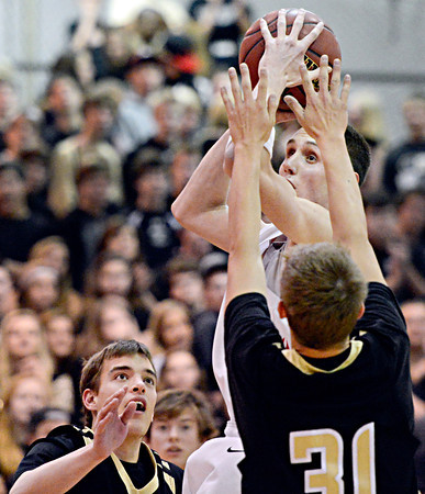"""Fairview's Austin Sparks looks to shoot over Monarch's Ben Beauchamp (31) during the game at Fairview High School on Thursday, Feb. 21, 2013. Fairview beat Monarch 60-51 to clinch the Front Range League title. For more photos visit  <a href=""""http://www.BoCoPreps.com"""">http://www.BoCoPreps.com</a>.<br /> (Greg Lindstrom/Times-Call)"""