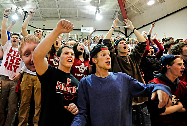 """Daniel Hoskins, left, Aaron MacArthur, right, and other Fairview students celebrate a basket late in the fourth quarter during the game at Fairview High School on Thursday, Feb. 21, 2013. Fairview beat Monarch 60-51 to clinch the Front Range League title. For more photos visit  <a href=""""http://www.BoCoPreps.com"""">http://www.BoCoPreps.com</a>.<br /> (Greg Lindstrom/Times-Call)"""