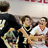 "Fairview's Trevor McQueeney (10) looks for a shot as Monarch's Jay MacIntyre (33) and Alex Krason (24) defend during the game at Fairview High School on Thursday, Feb. 21, 2013. Fairview beat Monarch 60-51 to clinch the Front Range League title. For more photos visit  <a href=""http://www.BoCoPreps.com"">http://www.BoCoPreps.com</a>.<br /> (Greg Lindstrom/Times-Call)"