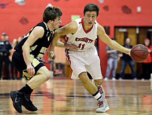"""Monarch's Jay MacIntyre (33) pressures Fairview's Cubby Lane (11) during the game at Fairview High School on Thursday, Feb. 21, 2013. Fairview beat Monarch 60-51 to clinch the Front Range League title. For more photos visit  <a href=""""http://www.BoCoPreps.com"""">http://www.BoCoPreps.com</a>.<br /> (Greg Lindstrom/Times-Call)"""