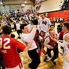 "Fairview students rush the court to celebrate with players after the game at Fairview High School on Thursday, Feb. 21, 2013. Fairview beat Monarch 60-51 to clinch the Front Range League title. For more photos visit  <a href=""http://www.BoCoPreps.com"">http://www.BoCoPreps.com</a>.<br /> (Greg Lindstrom/Times-Call)"