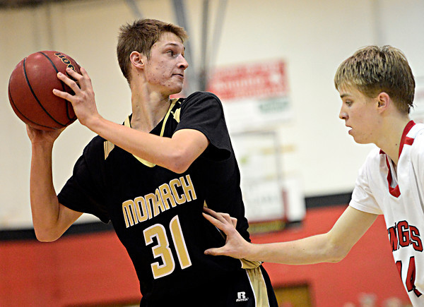 "Monarch's Ben Beauchamp (31) is defended by Fairview's Dakota Pilkington (14) during the game at Fairview High School on Thursday, Feb. 21, 2013. Fairview beat Monarch 60-51 to clinch the Front Range League title. For more photos visit  <a href=""http://www.BoCoPreps.com"">http://www.BoCoPreps.com</a>.<br /> (Greg Lindstrom/Times-Call)"