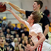 "Monarch's Ben Beauchamp blocks a shot by Fairview's Brent Wrapp during the game at Fairview High School on Thursday, Feb. 21, 2013. Fairview beat Monarch 60-51 to clinch the Front Range League title. For more photos visit  <a href=""http://www.BoCoPreps.com"">http://www.BoCoPreps.com</a>.<br /> (Greg Lindstrom/Times-Call)"