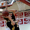 "Monarch's Alex Krason (24) goes up for a shot against Fairview's Austin Sparks during the game at Fairview High School on Thursday, Feb. 21, 2013. Fairview beat Monarch 60-51 to clinch the Front Range League title. For more photos visit  <a href=""http://www.BoCoPreps.com"">http://www.BoCoPreps.com</a>.<br /> (Greg Lindstrom/Times-Call)"