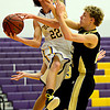 "Boulder's RJ Lampert (22) is fouled by Monarch's Erik Lawson during the game at Boulder High School on Tuesday, Jan. 8, 2013. Monarch beat Boulder 51-49. For more photos visit  <a href=""http://www.BoCoPreps.com"">http://www.BoCoPreps.com</a>.<br /> (Greg Lindstrom/Times-Call)"