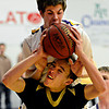 "Monarch's Drew Weaver (14) is fouled by Boulder's Cooper Bohm during the game at Boulder High School on Tuesday, Jan. 8, 2013. Monarch beat Boulder 51-49. For more photos visit  <a href=""http://www.BoCoPreps.com"">http://www.BoCoPreps.com</a>.<br /> (Greg Lindstrom/Times-Call)"