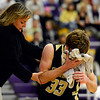 "Monarch's Jay MacIntyre (33) gets help from a trainer after taking an elbow to the face during the game at Boulder High School on Tuesday, Jan. 8, 2013. Monarch beat Boulder 51-49. For more photos visit  <a href=""http://www.BoCoPreps.com"">http://www.BoCoPreps.com</a>.<br /> (Greg Lindstrom/Times-Call)"