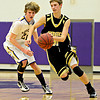"Monarch's Ben Beauchamp, right, drives past Boulder's Kevin VanLieshout (21) during the game at Boulder High School on Tuesday, Jan. 8, 2013. Monarch beat Boulder 51-49. For more photos visit  <a href=""http://www.BoCoPreps.com"">http://www.BoCoPreps.com</a>.<br /> (Greg Lindstrom/Times-Call)"