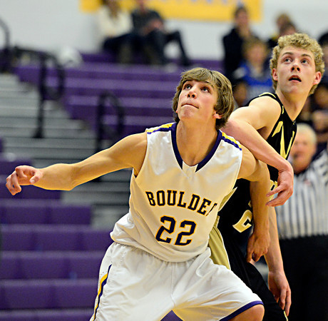 "Boulder's RJ Lampert (22) boxes out Monarch's Erik Lawson during the game at Boulder High School on Tuesday, Jan. 8, 2013. Monarch beat Boulder 51-49. For more photos visit  <a href=""http://www.BoCoPreps.com"">http://www.BoCoPreps.com</a>.<br /> (Greg Lindstrom/Times-Call)"