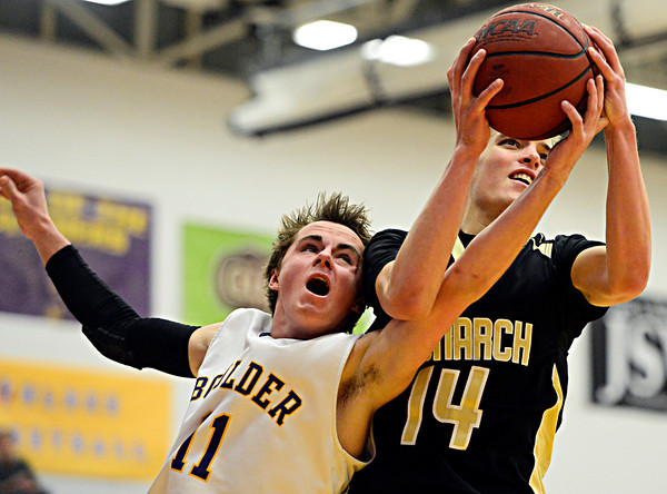 "Monarch's Drew Weaver (14) grabs a rebound over Boulder's Joe Szarmach (11) during the game at Boulder High School on Tuesday, Jan. 8, 2013. Monarch beat Boulder 51-49. For more photos visit  <a href=""http://www.BoCoPreps.com"">http://www.BoCoPreps.com</a>.<br /> (Greg Lindstrom/Times-Call)"