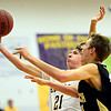 "Boulder's Kevin VanLieshout (21) goes up for a shot over Monarch's Ben Beauchamp during the game at Boulder High School on Tuesday, Jan. 8, 2013. Monarch beat Boulder 51-49. For more photos visit  <a href=""http://www.BoCoPreps.com"">http://www.BoCoPreps.com</a>.<br /> (Greg Lindstrom/Times-Call)"