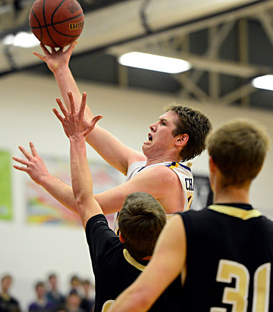 "Boulder's Jonah Charnick shoots over Monarch defenders during the game at Boulder High School on Tuesday, Jan. 8, 2013. Monarch beat Boulder 51-49. For more photos visit  <a href=""http://www.BoCoPreps.com"">http://www.BoCoPreps.com</a>.<br /> (Greg Lindstrom/Times-Call)"
