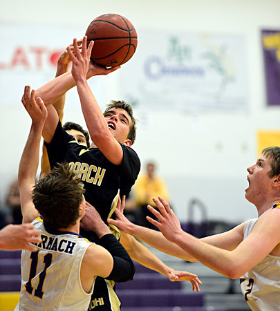 "Monarch's Drew Weaver shoots over Boulder's Joe Szarmach (11) during the game at Boulder High School on Tuesday, Jan. 8, 2013. Monarch beat Boulder 51-49. For more photos visit  <a href=""http://www.BoCoPreps.com"">http://www.BoCoPreps.com</a>.<br /> (Greg Lindstrom/Times-Call)"