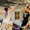 "Monarch's Ben Beauchamp (31) shoots over Boulder's Jonah Charnick (13) during the game at Boulder High School on Tuesday, Jan. 8, 2013. Monarch beat Boulder 51-49. For more photos visit  <a href=""http://www.BoCoPreps.com"">http://www.BoCoPreps.com</a>.<br /> (Greg Lindstrom/Times-Call)"