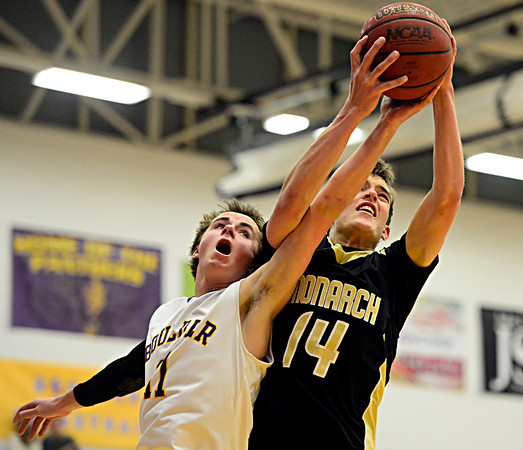 """Monarch's Drew Weaver (14) grabs a rebound over Boulder's Joe Szarmach (11) during the game at Boulder High School on Tuesday, Jan. 8, 2013. Monarch beat Boulder 51-49. For more photos visit  <a href=""""http://www.BoCoPreps.com"""">http://www.BoCoPreps.com</a>.<br /> (Greg Lindstrom/Times-Call)"""