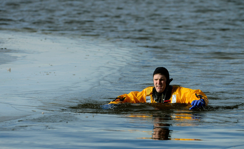 Firefighter Beau Clark floats in a pond during Mountain View Fire Rescue's annual ice rescue training Tuesday, Jan. 08, 2013 in a pond adjacent to the Weld County Services Center in Del Camino. Training in the 40 degree water will continue through Saturday for Mountain View's other shifts. (Lewis Geyer/Times-Call)