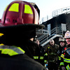 Battalion Chiefs Jen Nay, second from left, and Dave Beebe, right, lead a critique as Mountain View Fire Rescue firefighters participate in a live fire drill Tuesday night, March 5, 2013, at the Boulder County Regional Fire Training Center in Longmont. Crews from Station 7, out of Dacono, and Station 3, out of Mead, practiced forced entry and transitional attacks during the drill.<br /> (Greg Lindstrom/Times-Call)