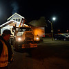 """Mike Bucklen directs Gary Sorenson, the driver with DeJohn Housemoving Inc., as they move the blue house from 508 Terry St. to 1800 Kristy Court in Prospect on Wednesday, Nov. 14, 2012.  For more photos and a video visit  <a href=""""http://www.TimesCall.com"""">http://www.TimesCall.com</a>.<br /> (Greg Lindstrom/Times-Call)"""