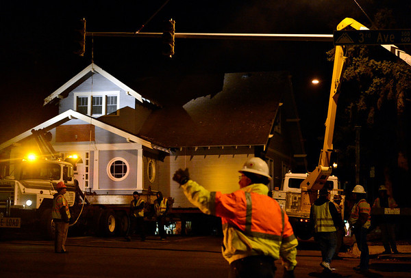 """A stop light is adjusted at the intersection of Third Avenue and Coffman Street as DeJohn Housemoving Inc., moves the blue house from 508 Terry St. to 1800 Kristy Court in Prospect on Wednesday, Nov. 14, 2012.  For more photos and a video visit  <a href=""""http://www.TimesCall.com"""">http://www.TimesCall.com</a>.<br /> (Greg Lindstrom/Times-Call)"""