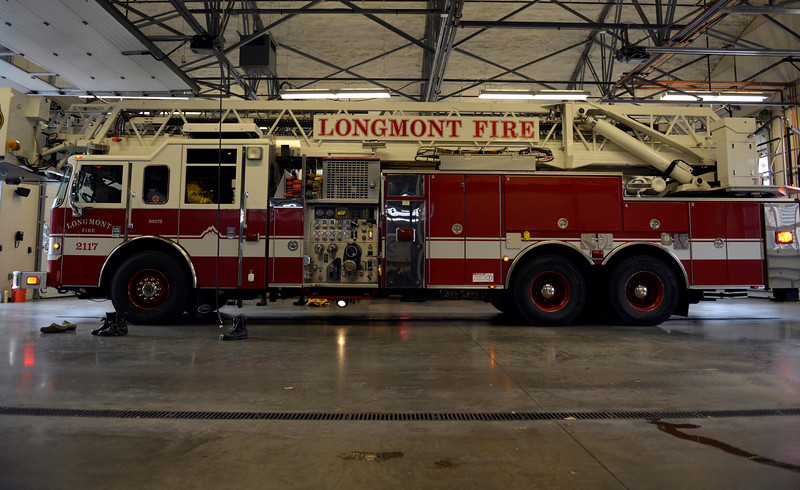 A fire truck is seen preparing to leave a station in response to a call Monday, Nov. 26, 2012, at the Longmont Fire Department Station 1.<br /> (Elaine Cromie/For the Times-Call)