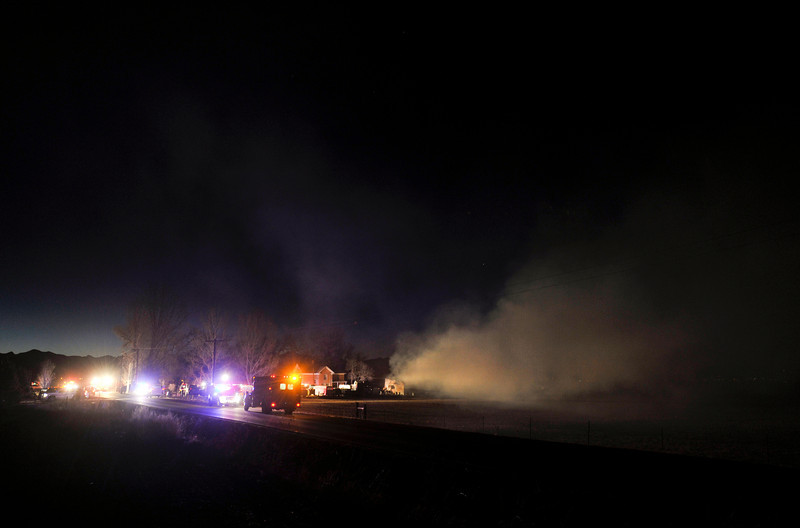 Firefighters from multiple agencies work to contain a blaze in a workshop at 10111 Niwot Road, Friday, Jan. 18, 2013, in Niwot.<br /> (Matthew Jonas/Times-Call)