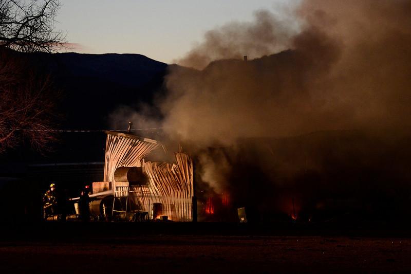 20130118_NIWOT_FIRE_6933.jpg Firefighters work to contain a fire in a barn, Friday, Jan. 18, 2013, in Niwot.<br /> (Matthew Jonas/Times-Call)