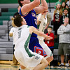 Centaurus High School's Mike DeVries (No. 55) drives to the basket between Niwot High School's Austin Hart (No. 1) and Kyle Kolakowski (No. 12), Friday, Feb. 15, at NHS. The Cougars defeated the Warriors, 56-53.<br /> (Matthew Jonas/Times-Call)