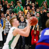 Niwot High School's Nate Merriman (No. 5) shoots a free throw as fans  and Niwot's mascot silently cheer him on during the game against Centaurus High School, Friday, Feb. 15, at NHS. The Cougars defeated the Warriors, 56-53.<br /> (Matthew Jonas/Times-Call)