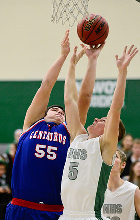 Centaurus High School's Mike DeVries (No. 55) puts up a shot past Niwot High School's Nate Merriman (No. 5), Friday, Feb. 15, at NHS. The Cougars defeated the Warriors, 56-53.<br /> (Matthew Jonas/Times-Call)