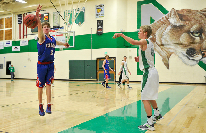 Centaurus High School's Lance Matosky (No. 2) blocks the inbounds pass from Niwot High School's Kyle Kolakowski (No. 12), Friday, Feb. 15, at NHS. The Cougars defeated the Warriors, 56-53.<br /> (Matthew Jonas/Times-Call)