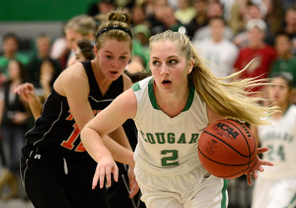 Niwot High School's Callie Hensen (No. 2) drives past Erie High School's Kenzie Kudrna (No. 12) during the third quarter, Friday, Nov. 30, 2012, at NHS.<br /> (Matthew Jonas/Times-Call)