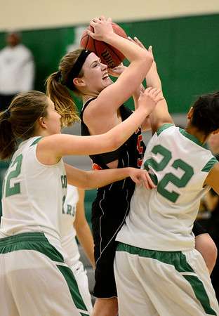 Erie High School's Piper Zeier (No. 53) tries to put up a shot between Niwot High School's Anessa Calvert (No. 22) and Anna Dunnell (No. 32) during the fourth quarter, Friday, Nov. 30, 2012, at NHS.<br /> (Matthew Jonas/Times-Call)
