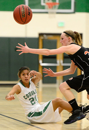 Niwot High School's Deyja Enriquez (No. 24) passes the ball after recovering it while Erie High School's Haley Gallagher (No. 32) tries to intercept during the first quarter, Friday, Nov. 30, 2012, at NHS.<br /> (Matthew Jonas/Times-Call)